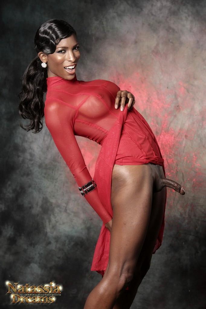 Black Natassia Posing In Red Skirt